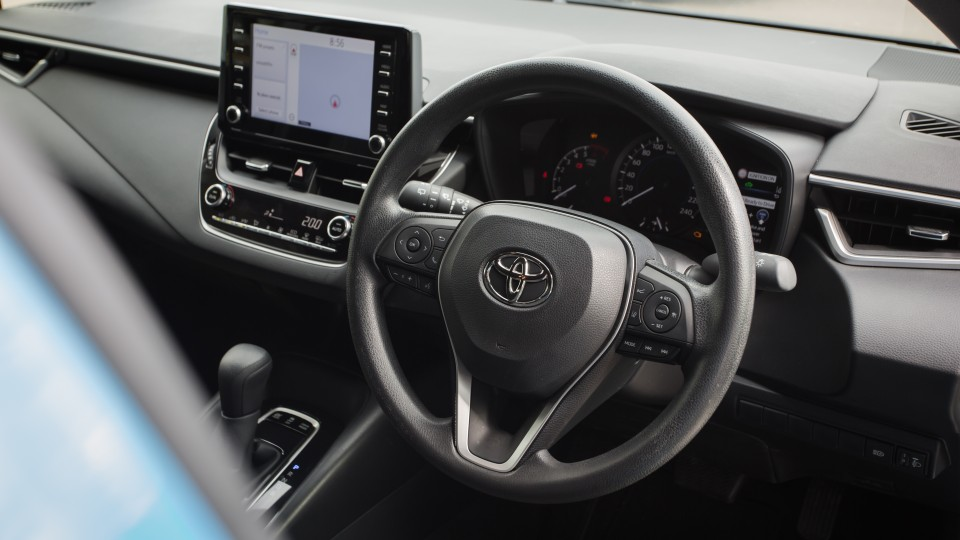 Drive Car of the Year Best Small Car of 2021 finalist Toyota Corolla Hybrid Hatch driver steering wheel dashboard and infotainment system