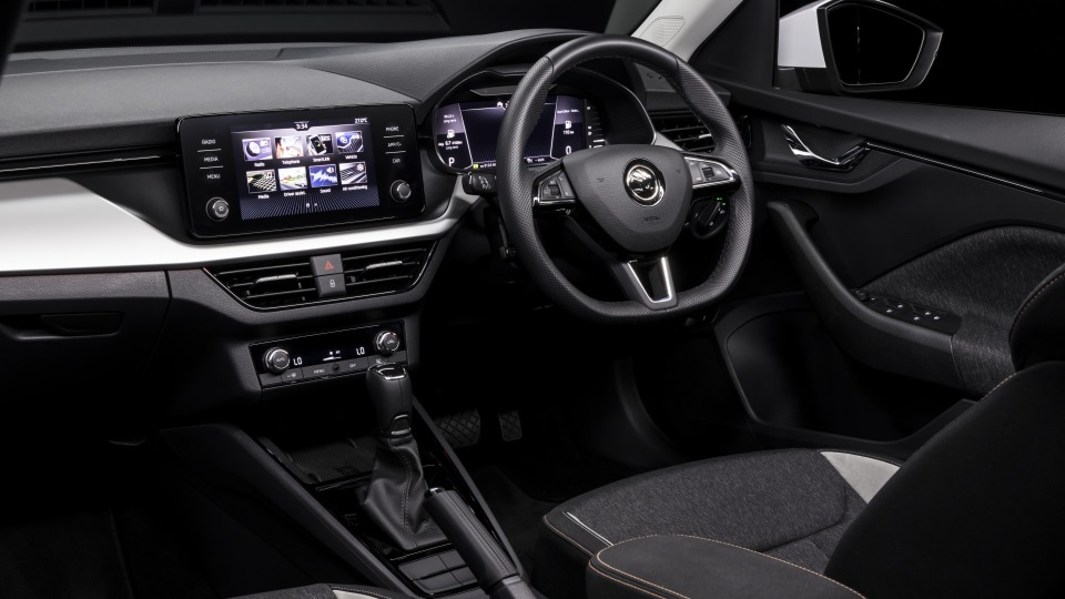 Drive Car of the Year Best Small SUV 2021 finalist Skoda Kamiq front interior infotainment system and steering wheel.