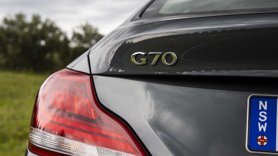 Drive Car of the Year Best Medium Luxury Car 2021 finalistGenesis G70 rear label view