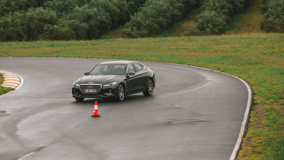 Drive Car of the Year Best Medium Luxury Car 2021 finalist Genesis G70 driven on road circuit