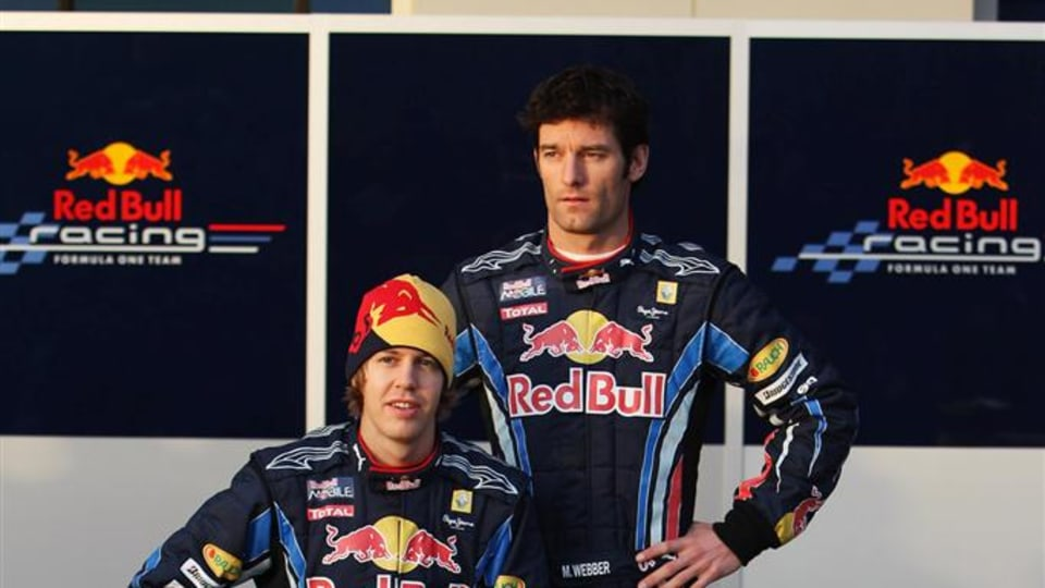 JEREZ DE LA FRONTERA, SPAIN - FEBRUARY 10:  Red Bull Racing drivers Mark Webber (R) of Australia and Sebastian Vettel (L) of Germany unveil the new RB6 during winter testing at the at the Circuito De Jerez on February 10, 2010 in Jerez de la Frontera, Spa