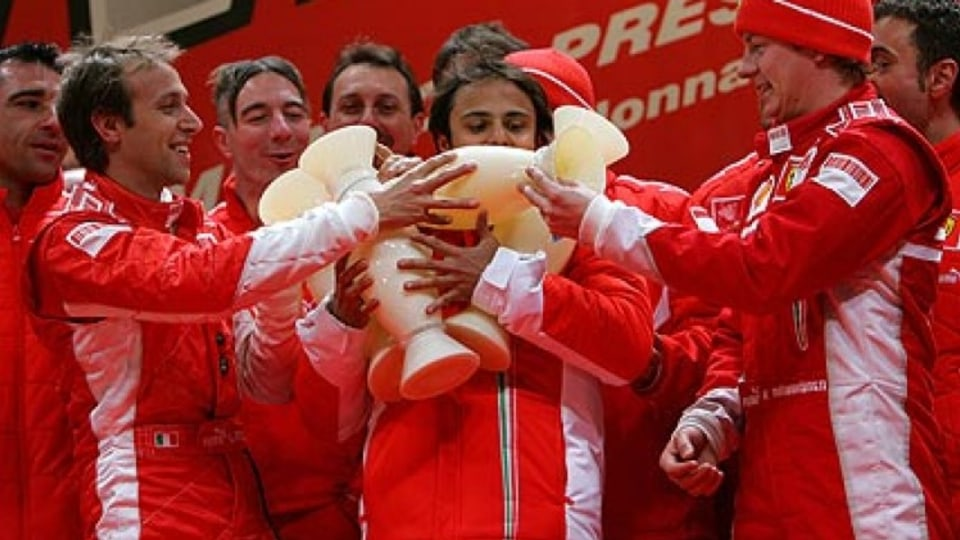 Ferrari's happy family: Raikkonen (right), Massa (centre) and Badoer clown around with an armful of trophies during an F1 press conference. January 12, 2007. Photo: Getty Images