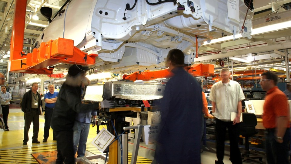 The first production-intent Chevrolet Volt is fitted with a lithium-ion battery pack at the General Motors Pre-Production Operations (PPO) building in Warren, Michigan Wednesday, June 3, 2009. The battery pack is a technologically-advanced component of th