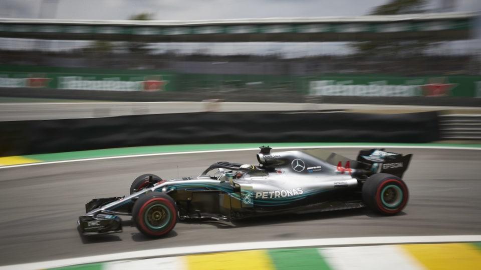 Hamilton wins after Verstappen clash