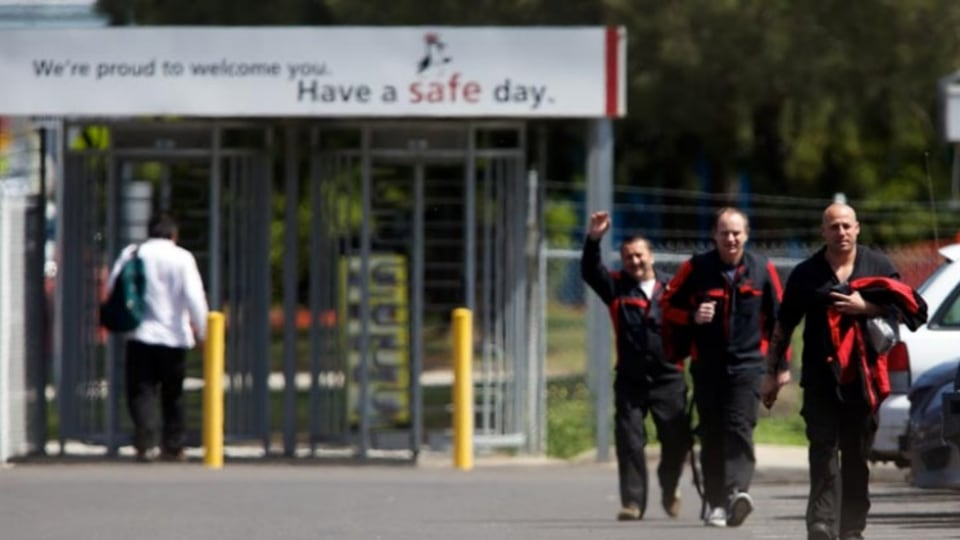 Toyota workers leave the manufacturing plant at Altona, Melbourne.