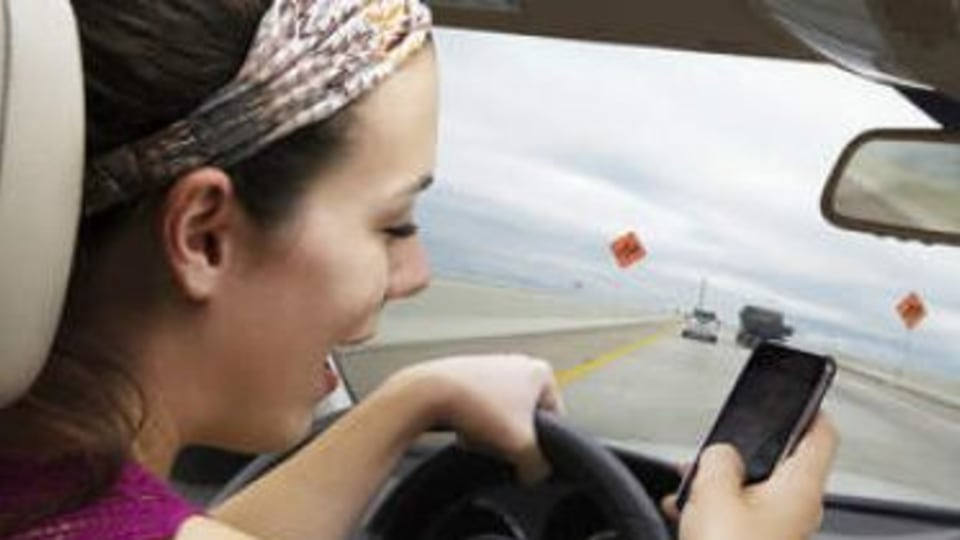Police crack down on drivers using mobiles
