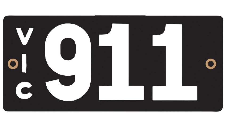 911 plate sells at auction