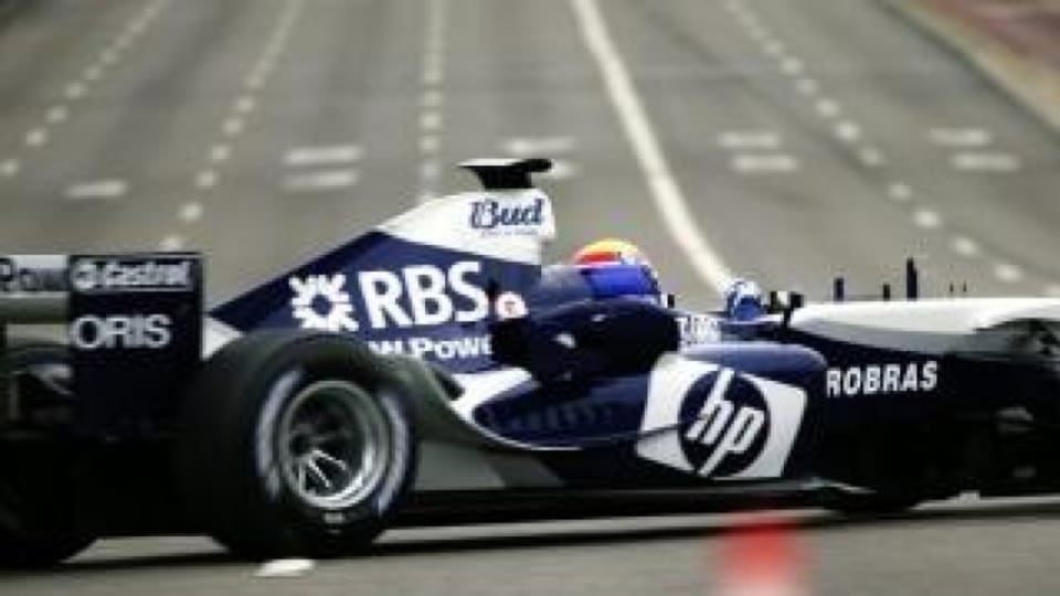 Mark Webber in a Williams BMW Formula One car on the Sydney Harbour Bridge, 2005.