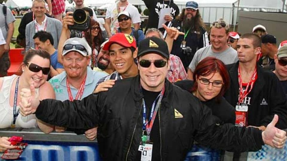 Actor John Travolta with fans.