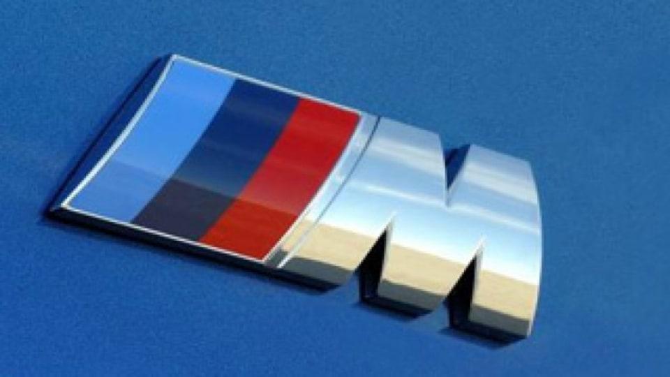 M badge
