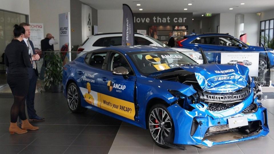 Crashed cars on display at dealerships