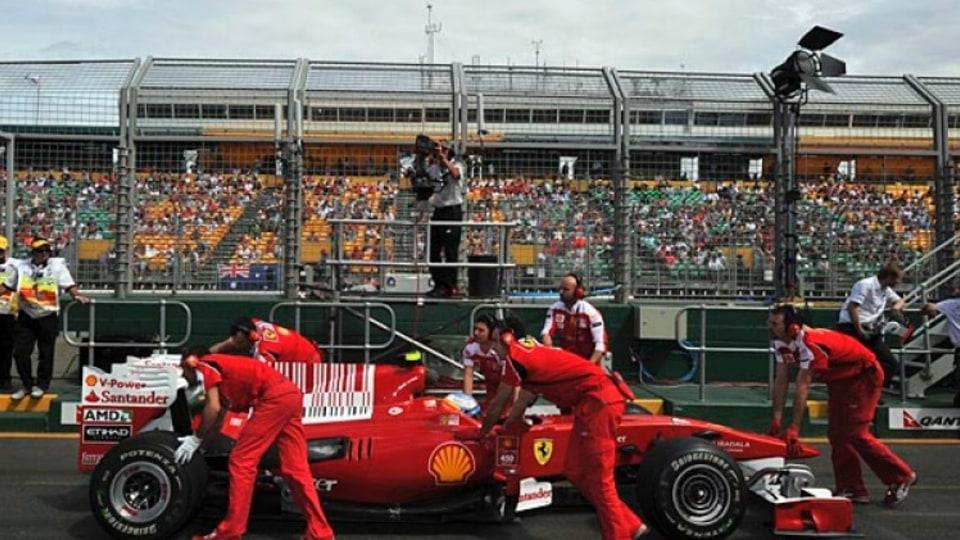 A Ferrari in pit lane.