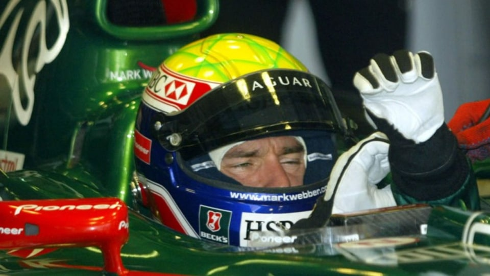 Jaguar's F1 driver Mark Webber of Australia prepares for the practice session for Malaysian Formula One Grand Prix at Sepang International Circuit, Malaysia, Saturday, March 20, 2004. (AP Photo/Dita Alangkara)