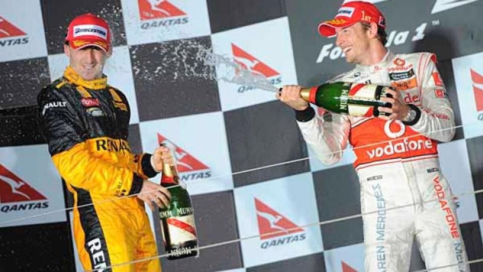 Jenson Button [McLaren ] after defeating Robert Kubica  [left]  and Felipe Massa.