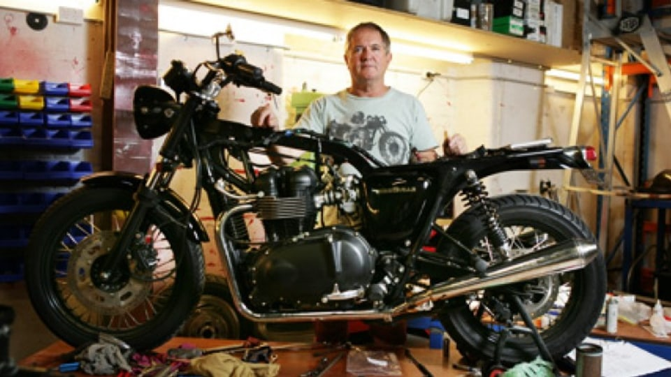 Two-wheel wonderment...Dare Jennings in the Deus Ex Machina workshop with a Triumph