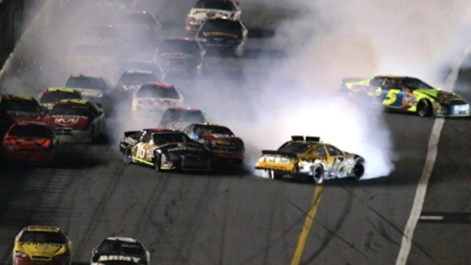 All hell breaks loose behind the leaders as winner Kevin Harvick (lower left) closes on Mark Martin in the sprint to the finish line. Picture: AP