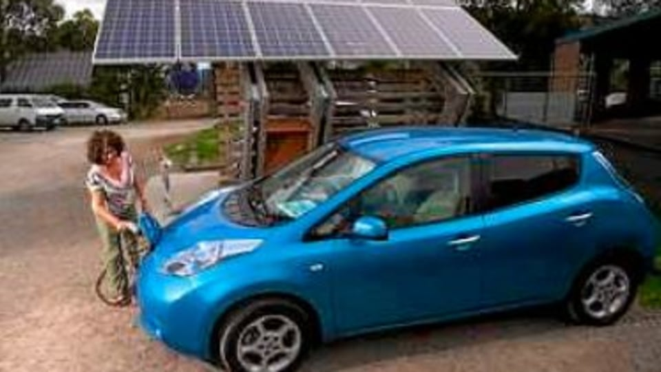 Judy Glick charging a car at the Solar charge station at CERES Community environment park in East Brunswick.