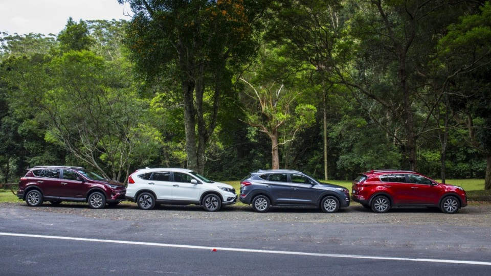 We pit the new Kia Sportage against some of the best mid-size SUVs on the market the Hyundai Tucson, Toyota RAV4 and Honda CR-V.
