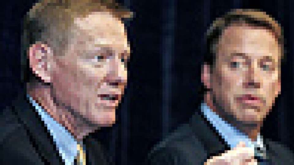 Getting to know you ... Alan Mulally, left, is introduced as the car maker's new boss by his predecessor, William Clay Ford jnr. Photo: AFP
