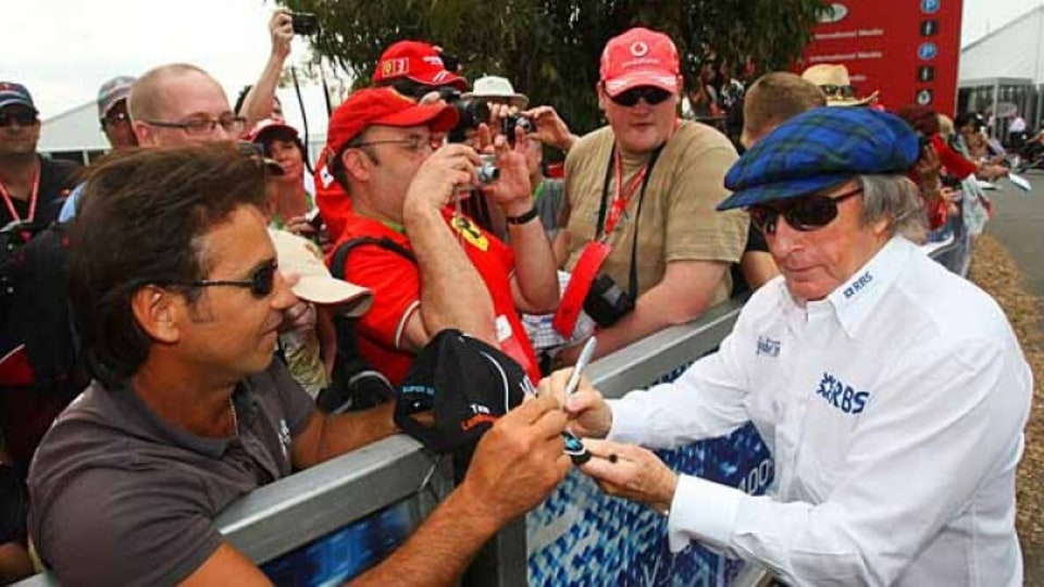 Jackie Stewart with Formula One fans.