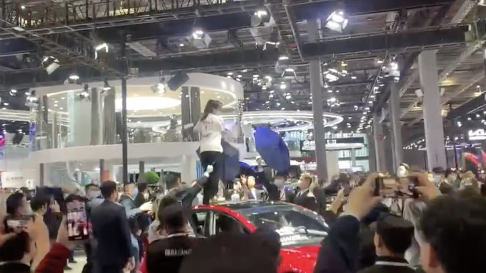 Tesla owner protests at Shanghai Motor Show, stands on roof yelling 'my brakes failed'