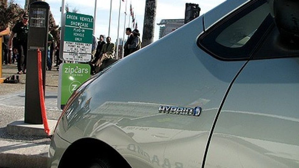 A hybrid car is charged in San Francisco.