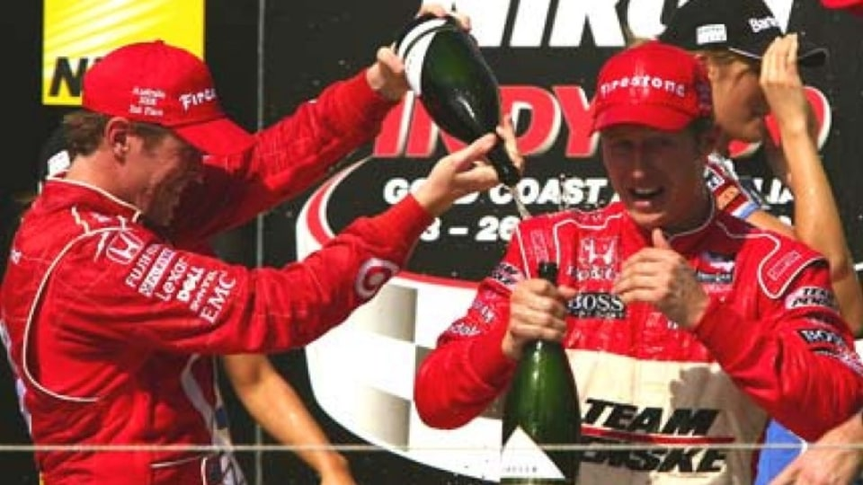 Scott Dixon celebrates his second place with winner Ryan Briscoe. Image: Getty images