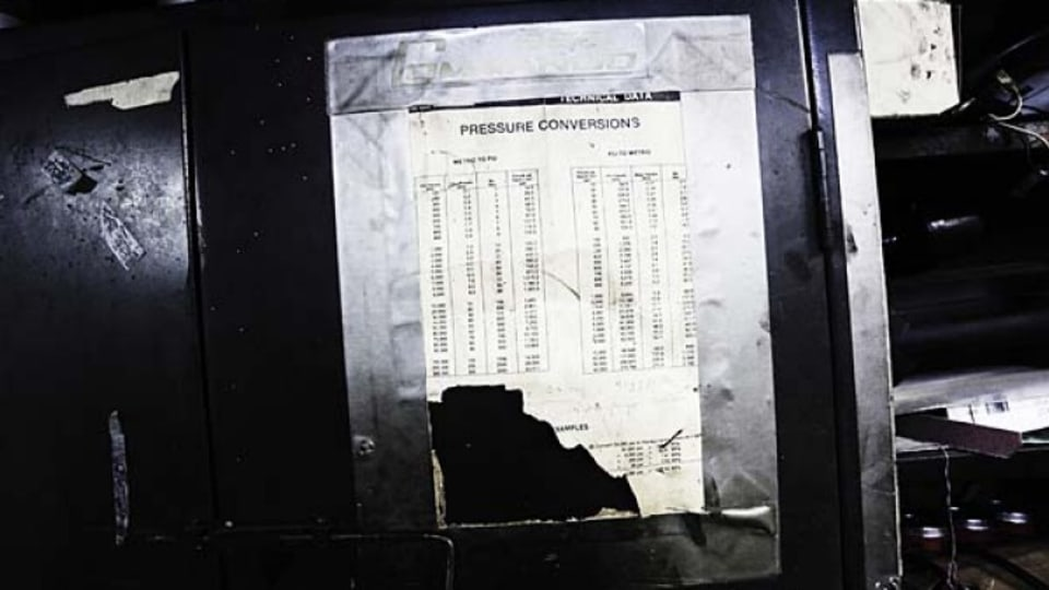A well-used pressure conversion table.