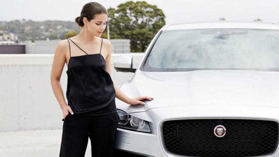 Sara Donaldson and a Jaguar F-Pace.