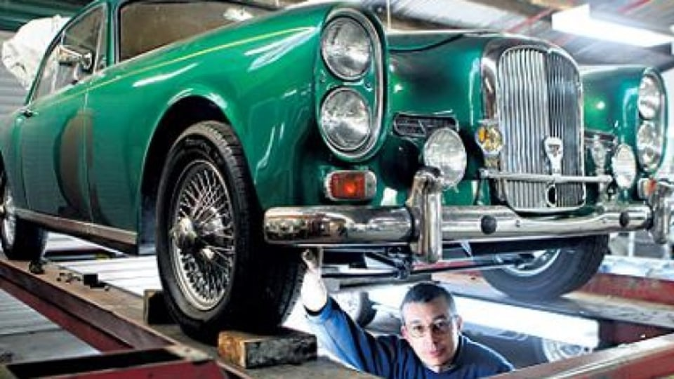 Expert touch ... Jonathan Houston working on a 1965 Alvis coupe.