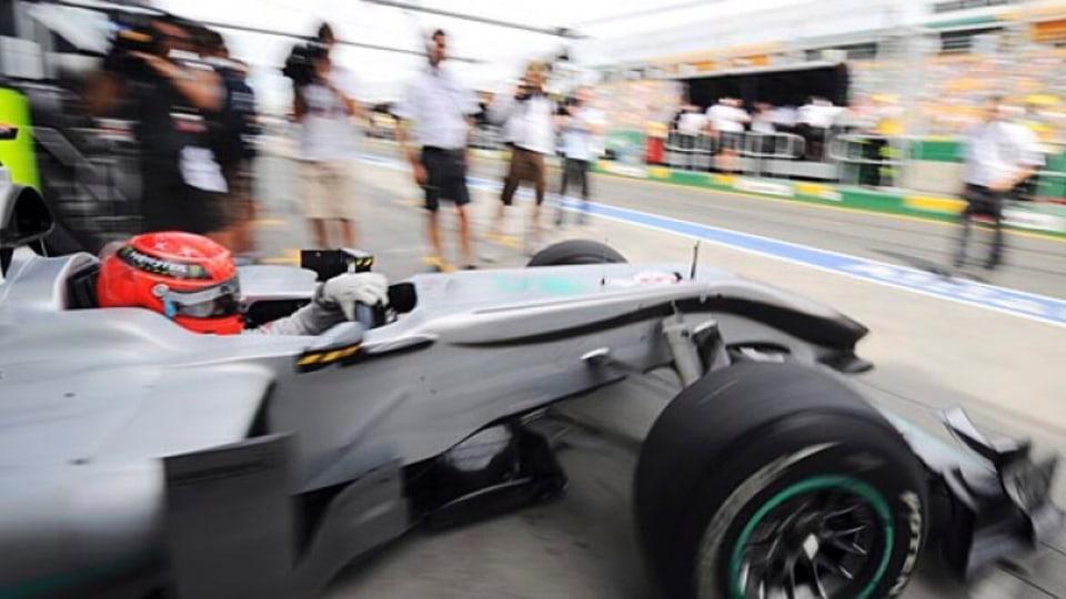 Michael Schumacher in his Mercedes in pit lane.