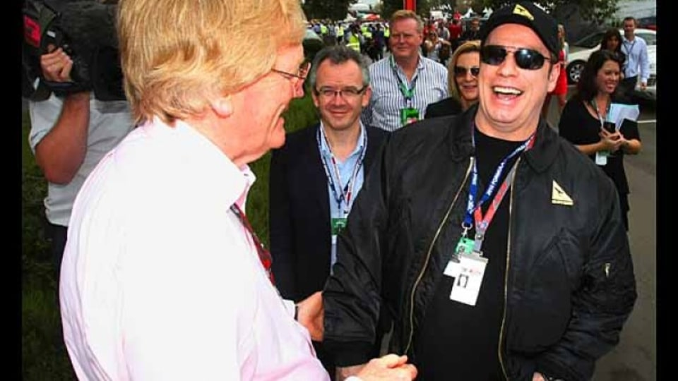 Ron Walker and John Travolta share a laugh.