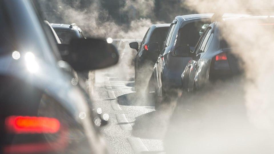 Smoke haze surrounds cars in traffic