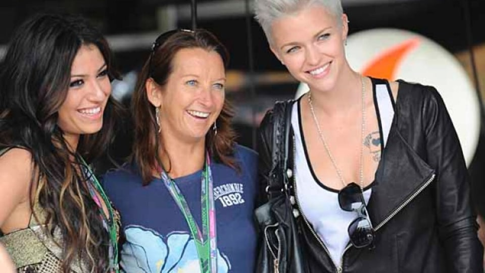Gabriella Cilmi , Layne Beachley and Ruby Rose walking in the pits.