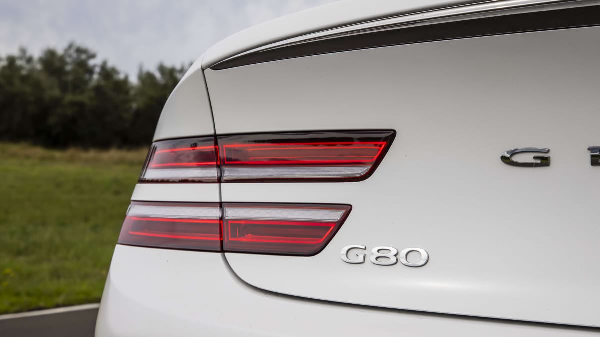 Drive Car of the Year Best Large Luxury Car 2021 finalist Genesis G80 left tail light and label close-up