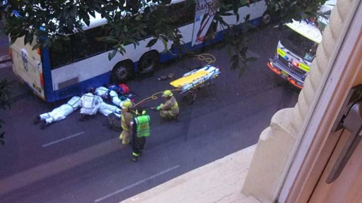 Paramedics treat the woman.