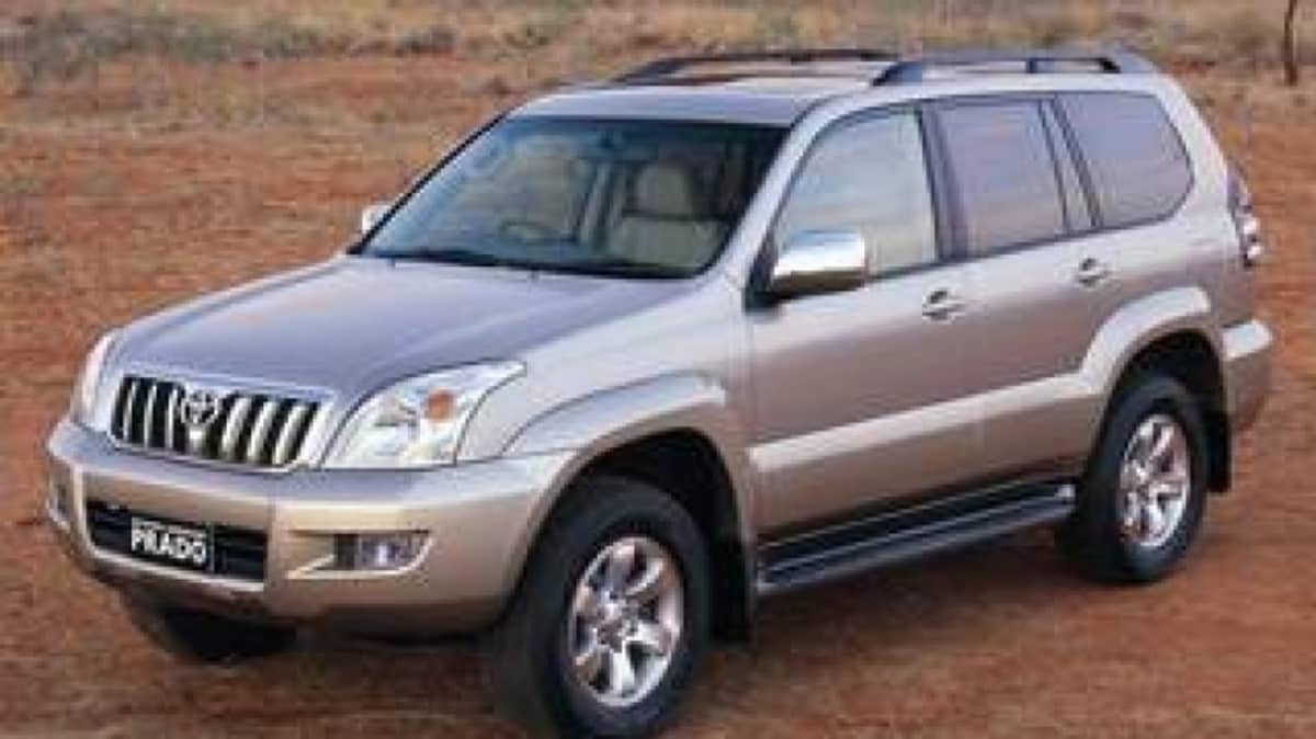 Toyota LandCruiser Prado Grande 2003.jpg  Toyota LandCruiser Prado Grande 2003 Front / side exterior view of silver Toyota Prado car / desert / 4WD
