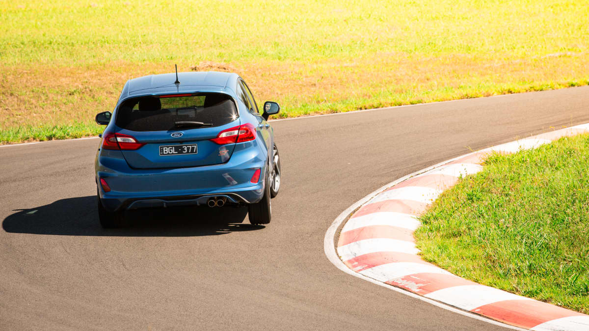 Drive Car of the Year Best Sports Car Under $100k finalist Ford Fiesta ST rear exterior driven around bend