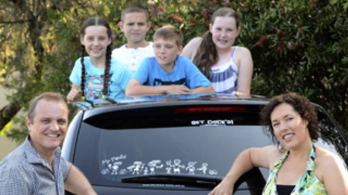Phil Barham and Monica Liebenow, pictured with  children (left to right) Amber, Sam, Jack and Erin, are the creators of the 'My Family' bumper stickers, which are now being exported.