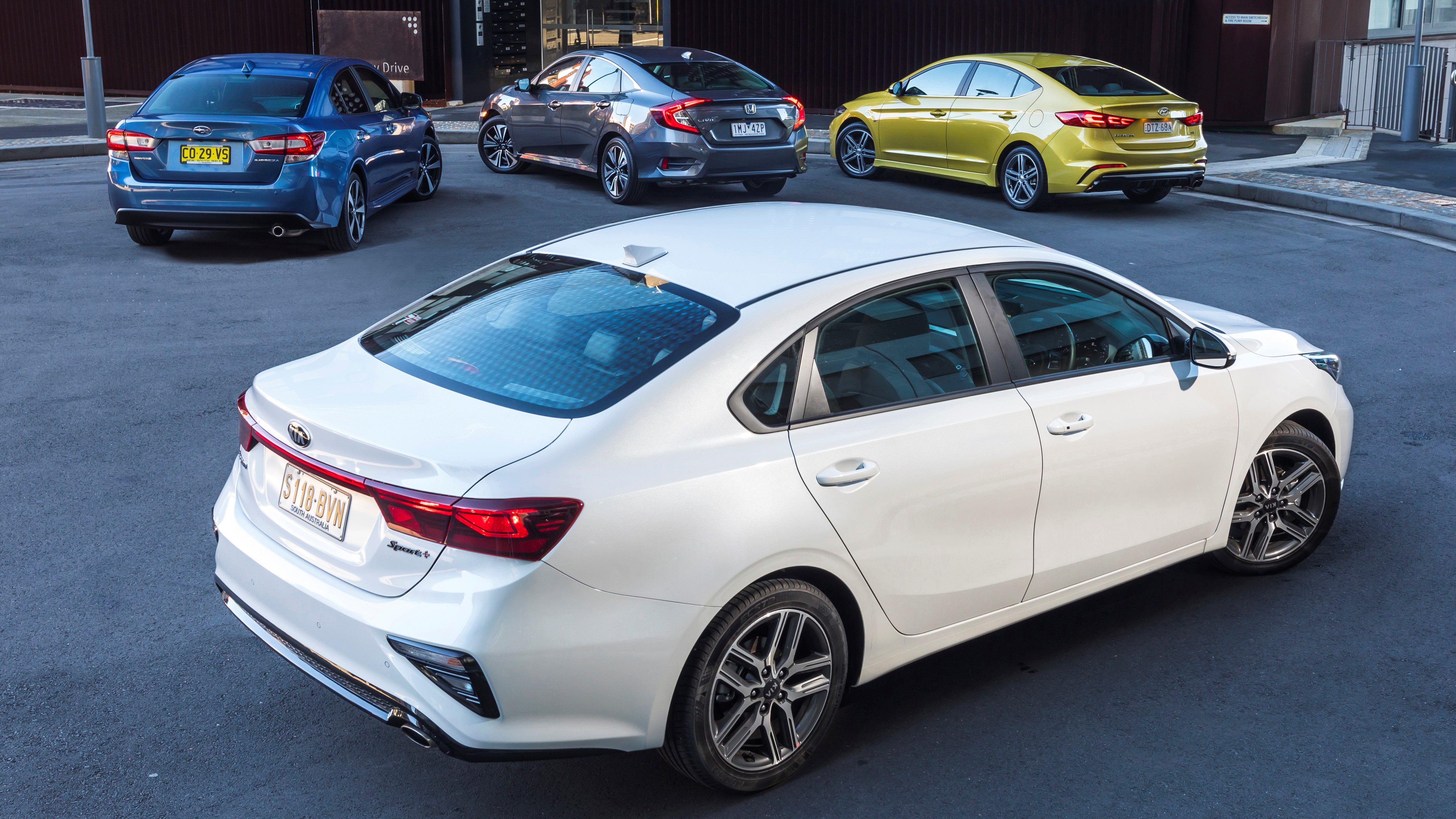 Small car comparison: Kia Cerato, Hyundai Elantra, Honda Civic and Subaru Impreza.