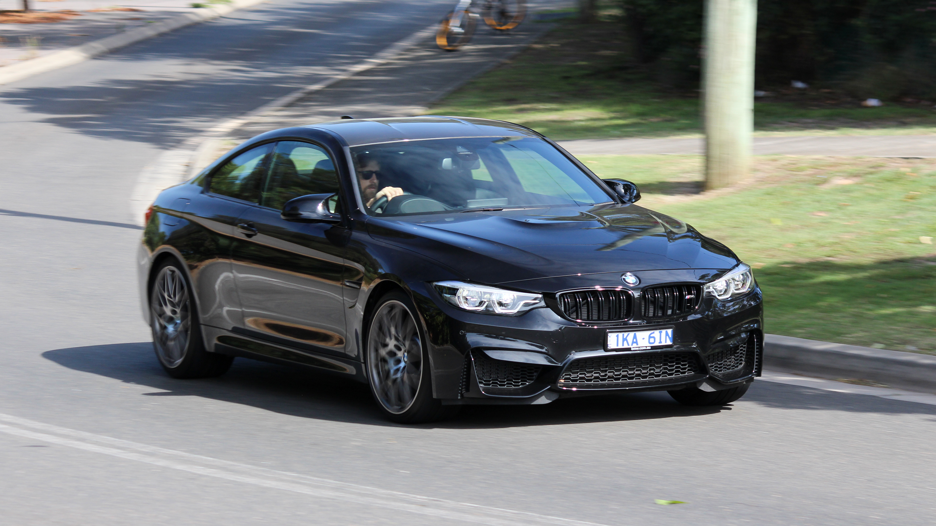 Head to head: BMW M4 Competition and Alpina B4S Coupe.