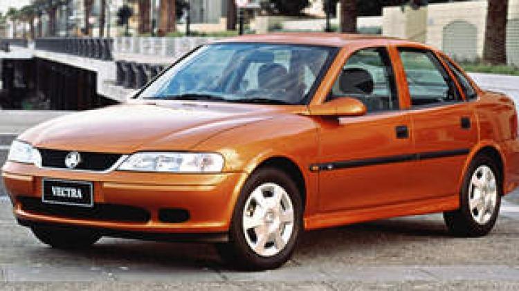 HOLDEN VECTRA . Brown car . Tan car .  SUNDAY DRIVE