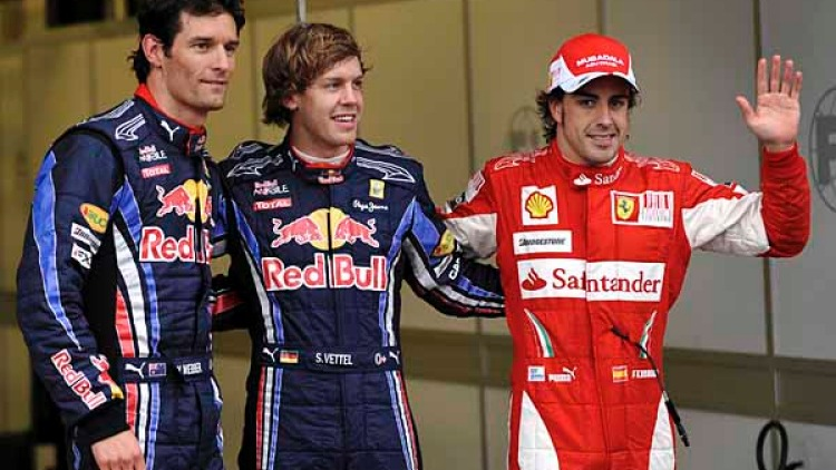 Fastest qualifier and poll position Sebastian Vettel (middle), second Mark Webber (left) and third  Fernando Alsonso.
