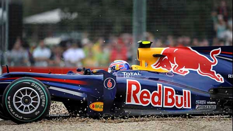 Mark Webber (Red Bull) hits the gravel pit after making contact with Felipe Massa (Ferrari).