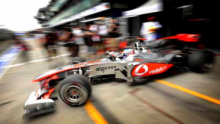 Jenson Button (McLaren) leaving the pits.