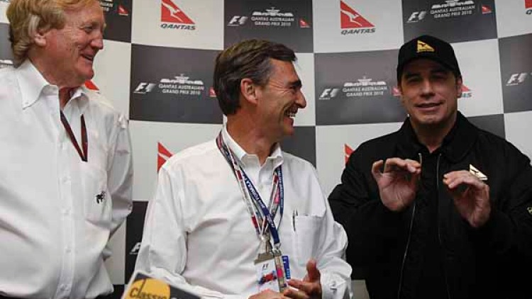Ron Walker, the Premier of Victoria John Brumby (left) with actor John Travolta during a press conference before the race.