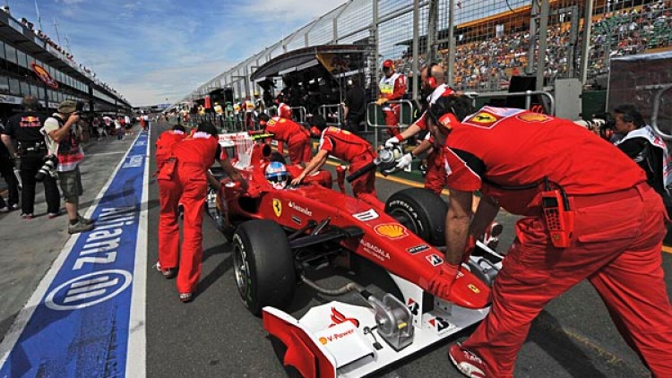 Ferrari's Fernando Alonso heads back to pit stop.