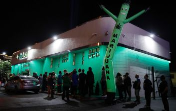 People line up at the NuLeaf marijuana dispensary, Saturday, July 1, 2017, in Las Vegas. Nevada dispensaries were legally allowed to sell recreational marijuana starting at 12:01 a.m. Saturday. (AP Photo/John Locher)
