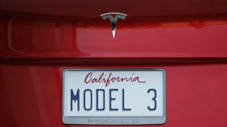 A license plate is displayed on a Tesla Motors Model 3.