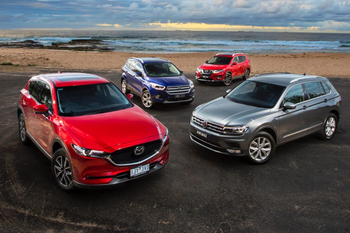 Mid-size SUV comparison: The new Mazda CX-5, Ford Escape and Nissan X-Trail take on the on the Volkswagen Tiguan.